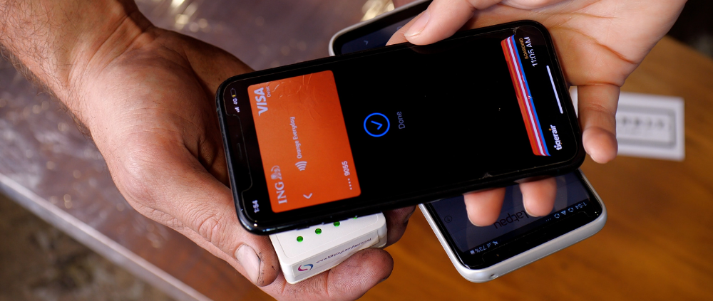 Using a mobile to make a payment on Latpay's all-in-one terminal